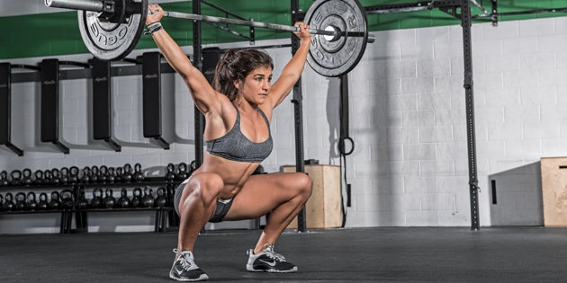 Cross Fit Women – Cropped view of young sportswoman posing with.