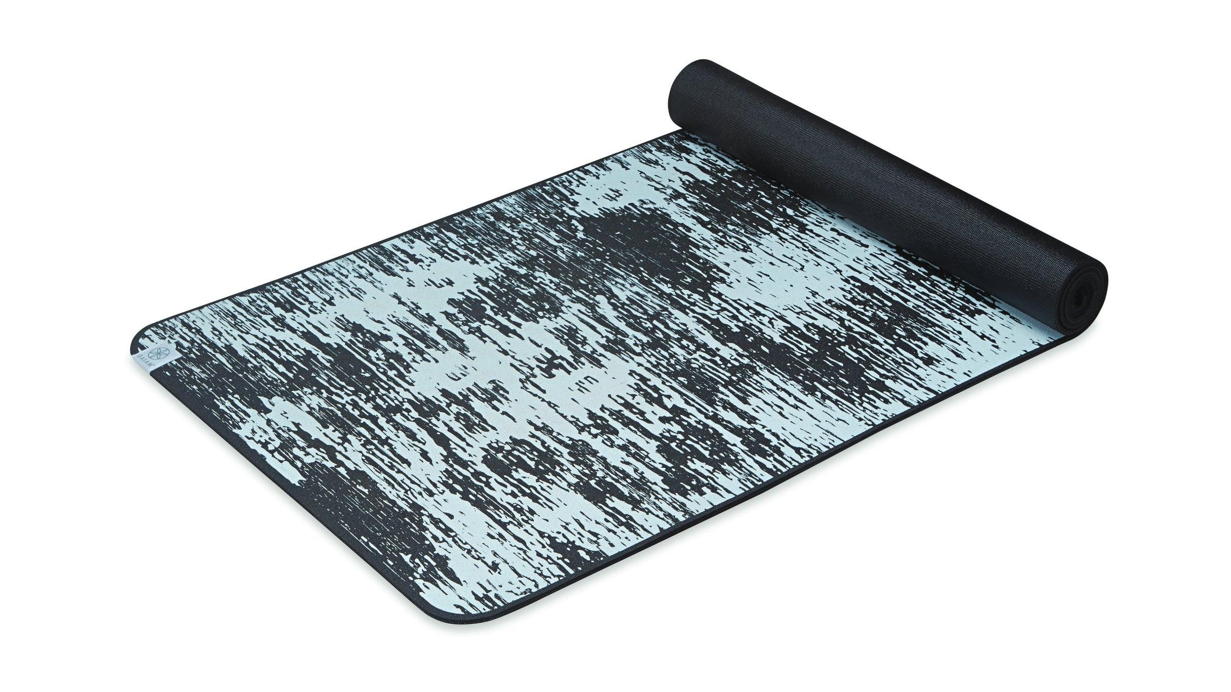 Black and gray yoga mat