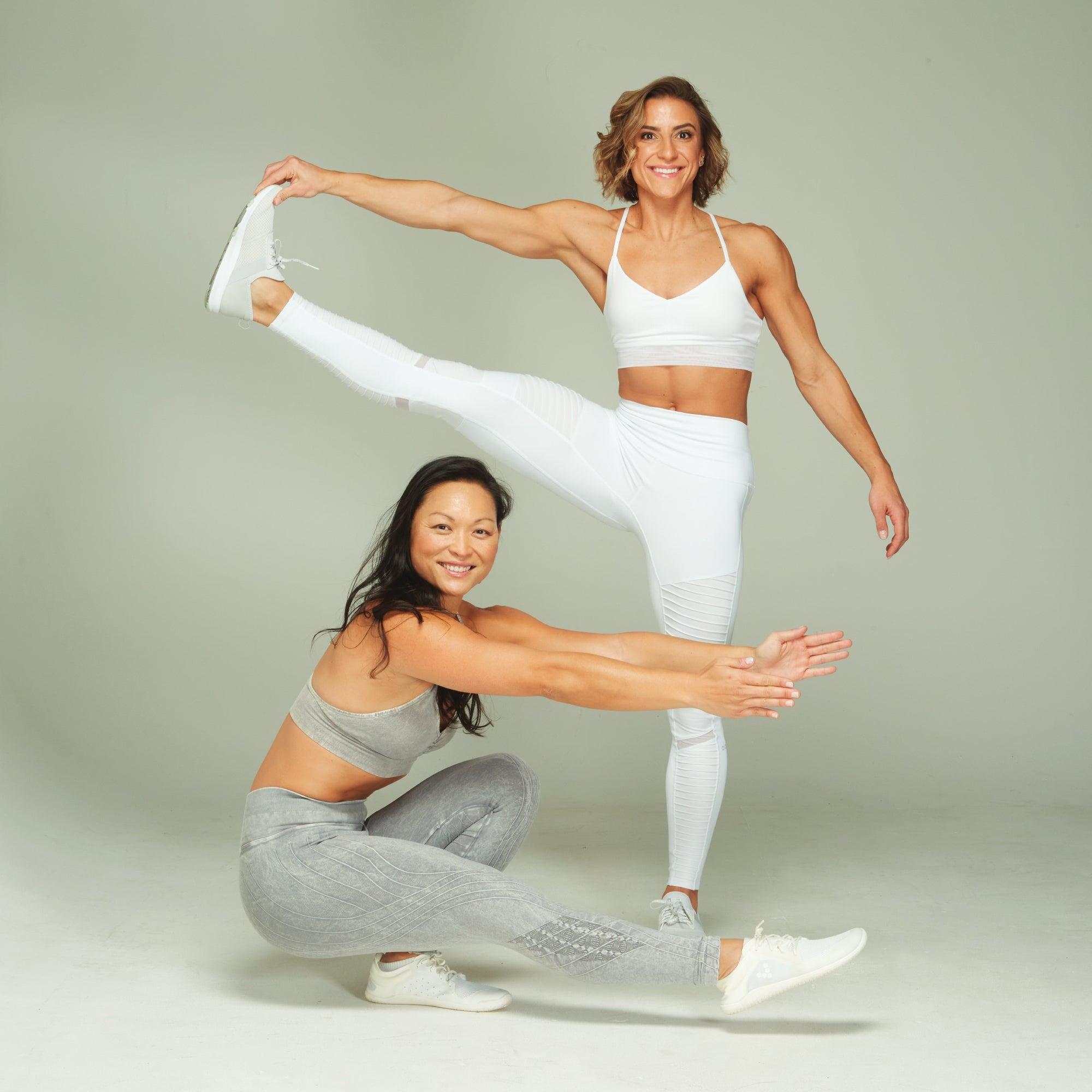 Venus Lau in a pistol squat and Tara Laferrara in a one-legged staff pose