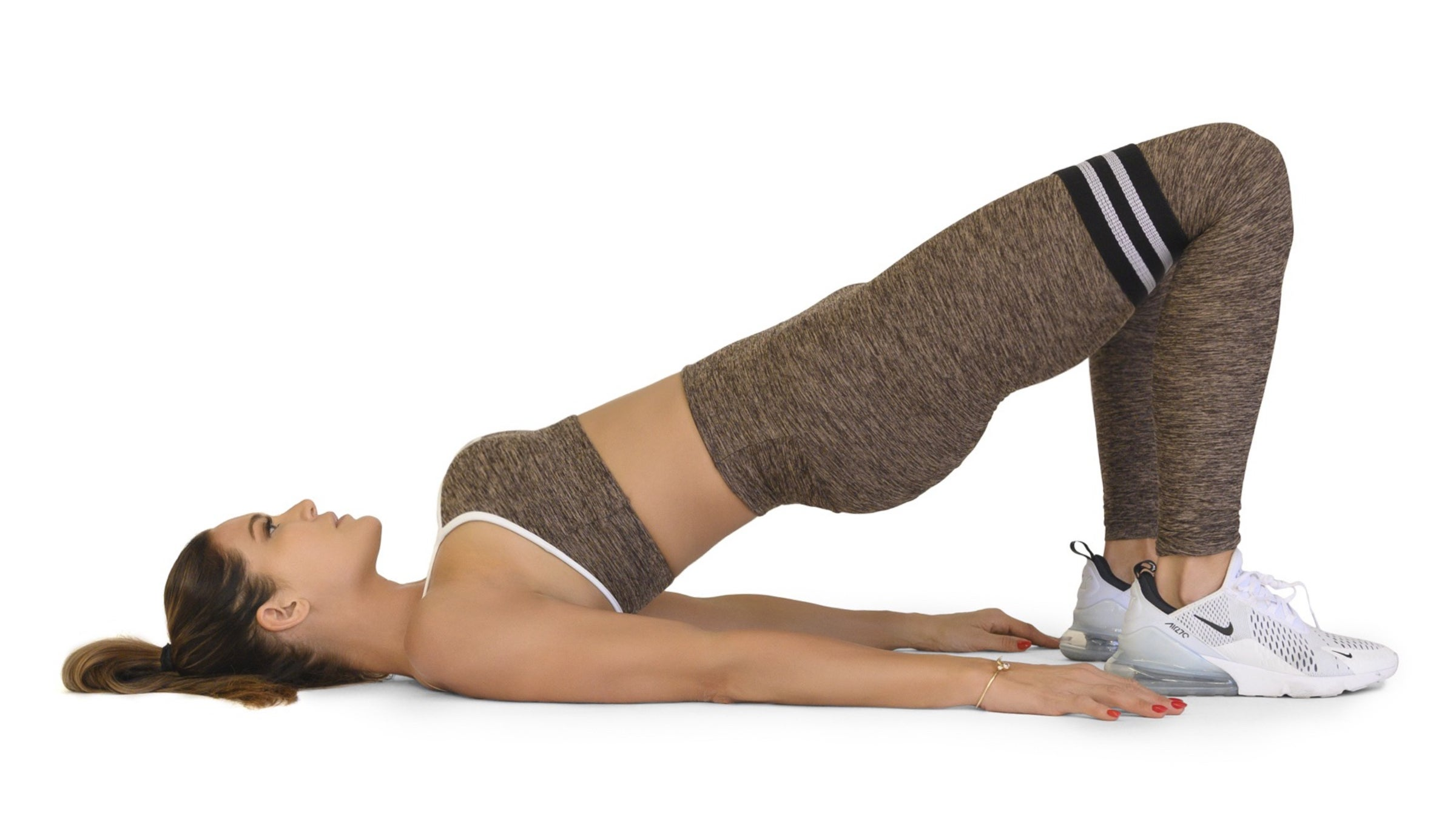 Woman in a full glute bridge extension
